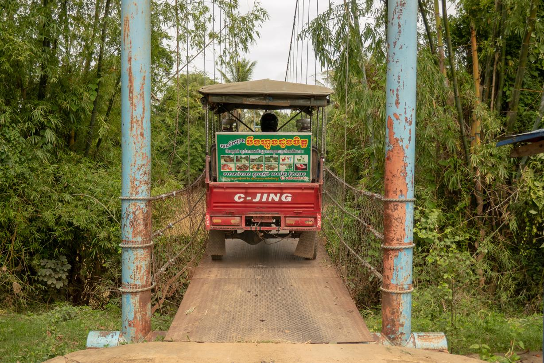 Crossing a narrow bridge on our Battambang Tuk Tuk Tour