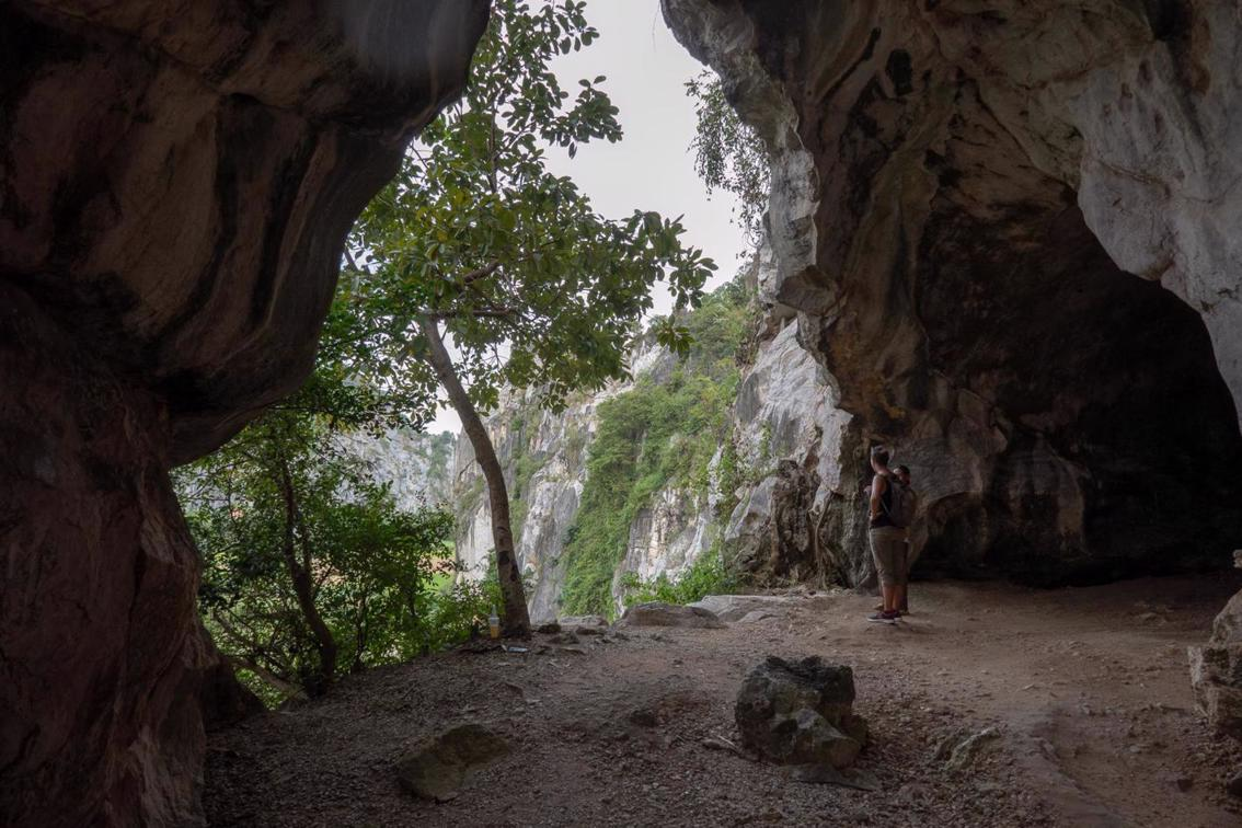 Exploring Kampot Caves - Kampong Trach cave temple in limestone mountains