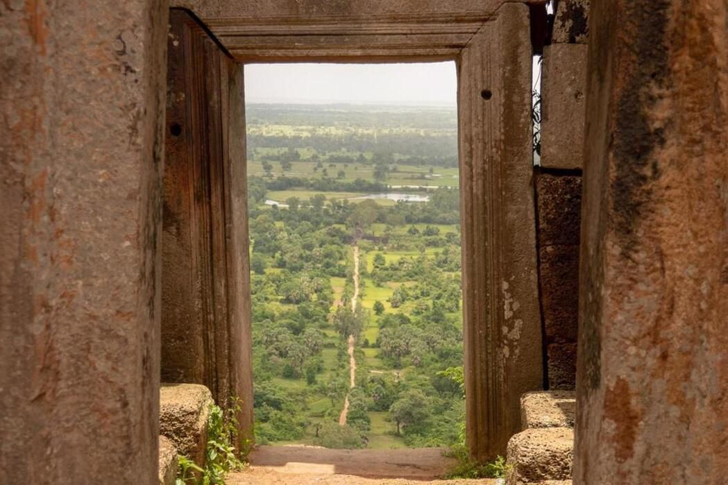 Dry Season in Cambodia - a beautiful view through the window of a mountain temple