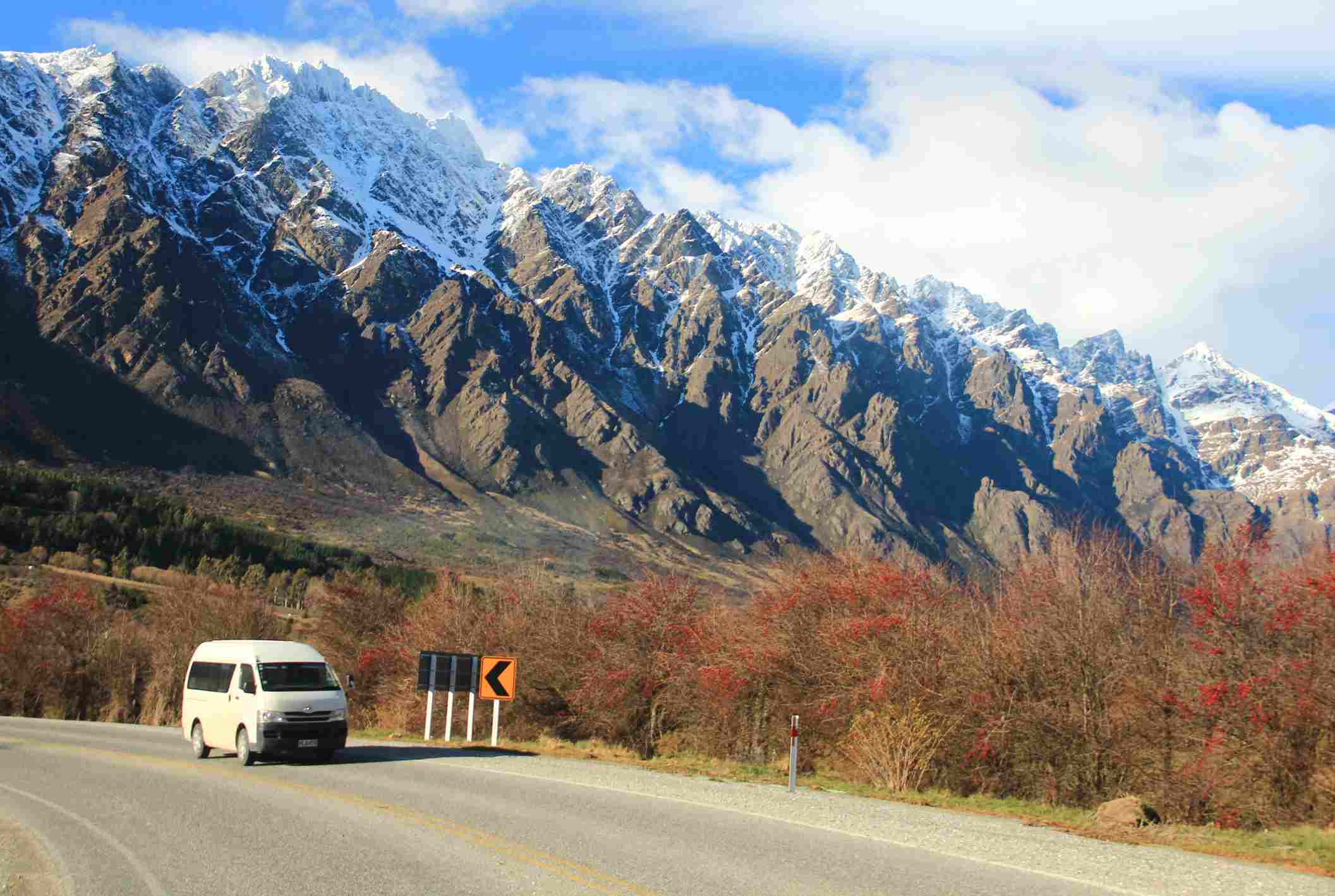 Campervan against backdrop of snowy mountains in New Zealand in winter